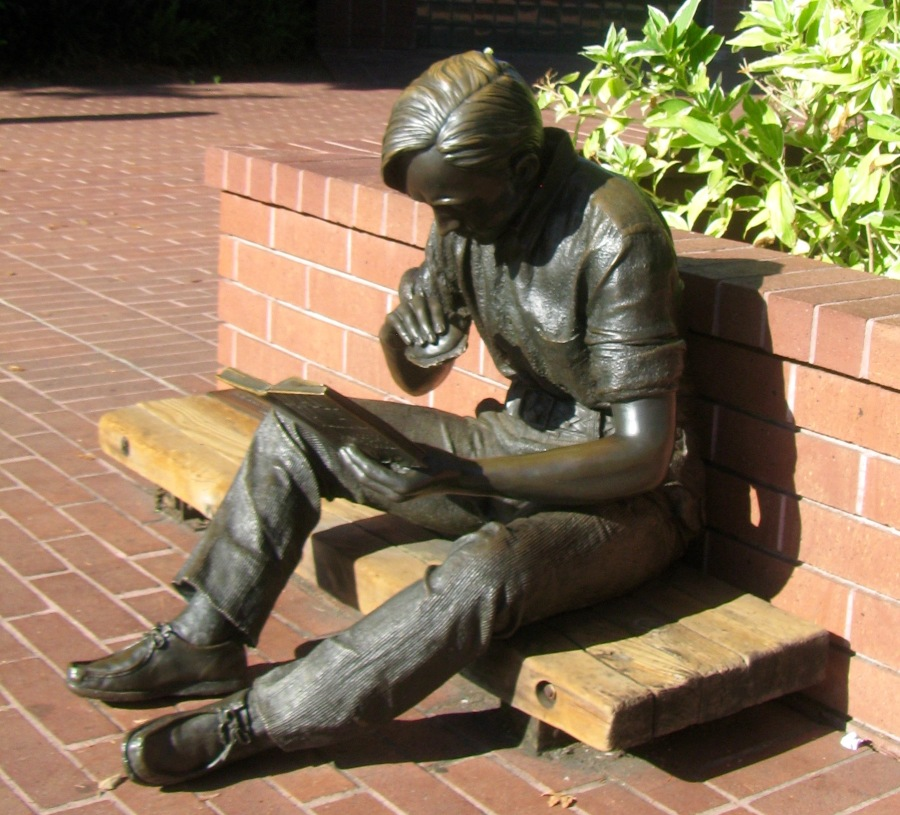 """Out to Lunch"" is a bronze statue by J. Seward Johnson. Known popularly as ""The Reading Guy,"" it is located outside the Sunnyvale Library."